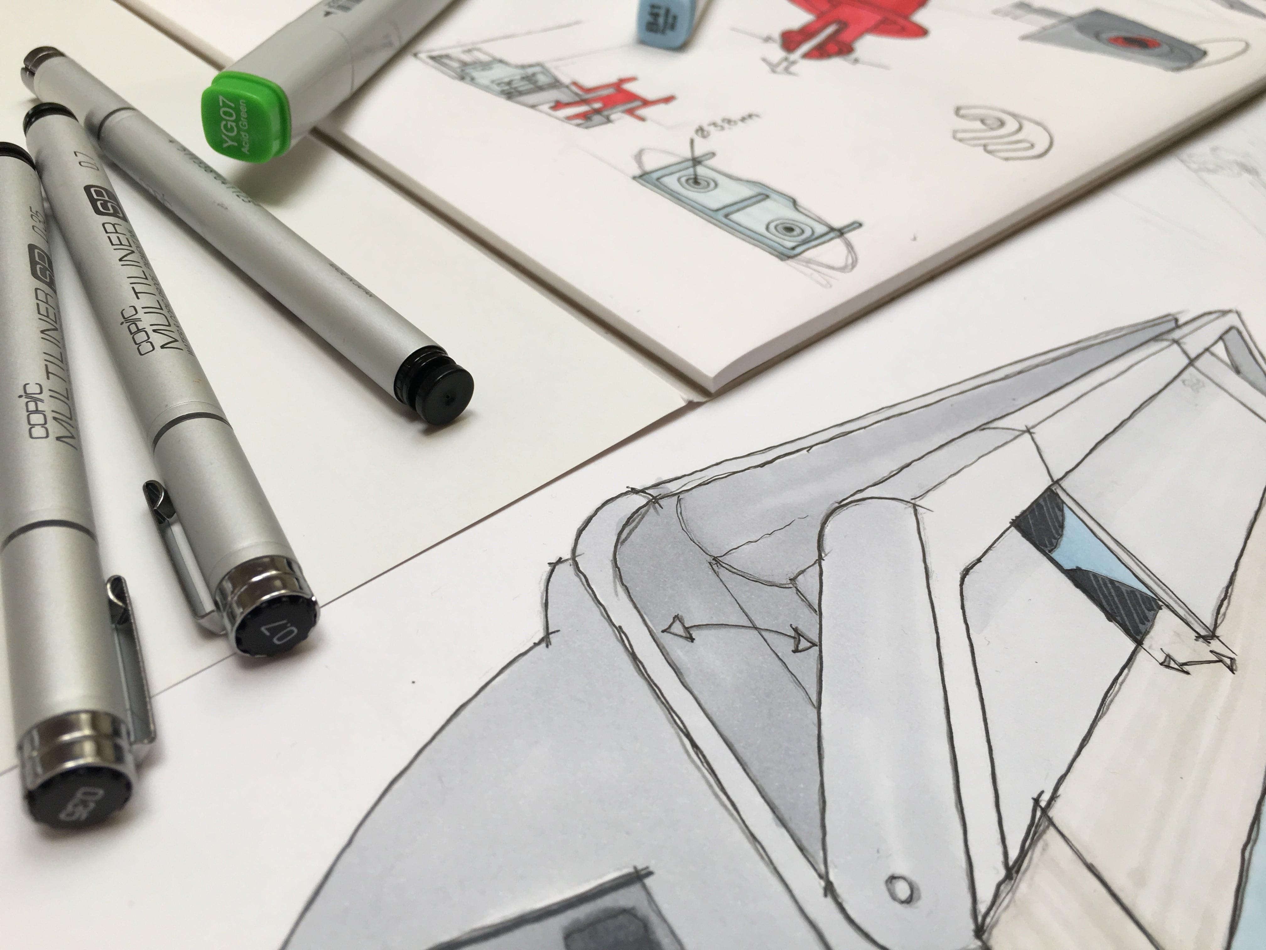 Farvelagte konceptskitser og Copic tuscher